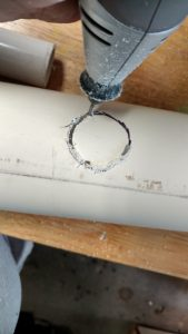 Cutting out the hole in PVC Pipe