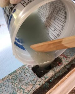 Pouring Thickened Epoxy Into Fiberglass repair