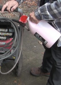 pouring in the pressure washer pump winterizing mix