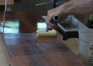 applying spar varnish rolling