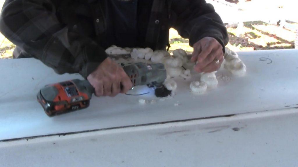 cutting away excess foam in hull repair