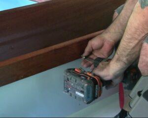 installing storage compartment crossbar